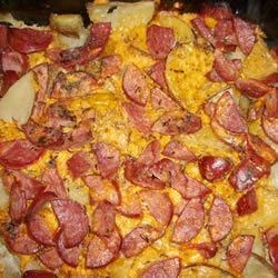 Sausage-Potato Casserole Recipe - Before you get out and shovel that snow, fortify yourself with kielbasa, potatoes and cheese baked with a dash of dried dill and nutty caraway seeds. What a great stick-to-your ribs, family-friendly casserole.