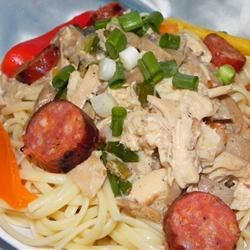 Andouille and Chicken Creole Pasta Recipe - Spicy andouille sausage and chicken are the starring attractions in this creamy mushroom sauce. Add some cayenne pepper if you like it even spicier!