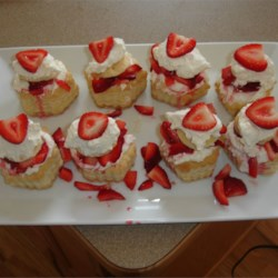 Strawberry Cream Cheese Clouds Recipe - A heavenly dessert made with packaged puff pastry shells, cream cheese filling and fresh strawberries.