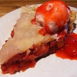 Strawberry Rhubarb Pie III Recipe -  Orange zest and tapioca are stirred into the strawberry-rhubarb filling, making this sweet pie especially luscious and citrusy. Choose either a top crust or a crumb topping.