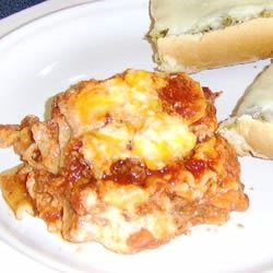 Brenda's Lasagna Recipe - Rich, gooey ricotta and mozzarella are accented by tangy Cheddar, layered with ground beef and a garlicky tomato sauce.