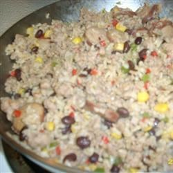Ann's Dirty Rice Recipe - A quick and colorful one-pot meal with bits of onion, green, and red bell peppers cooked with ground beef and rice.