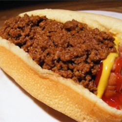 Heavenly Hot Dog Sauce Recipe - This savory beef topping takes hotdogs to a whole new level. Ground beef simmers with tomato sauce, ketchup, chili powder, crushed red peppers, and a touch of sugar.