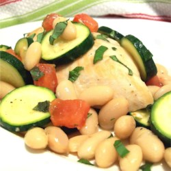 Italian White Bean Chicken Recipe - This one-dish meal features chicken breasts cooked with garlic, zucchini, white beans, and tomato.