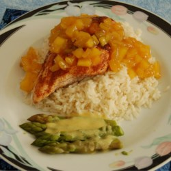 Grilled Spiced Chicken with Caribbean Citrus-Mango Sauce Recipe - A taste of the islands! The spices and sweet-tart sauce are a wonderful combination, and just the way to start the summer grilling season. Great with freshly steamed green beans.