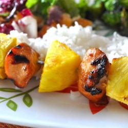 Hawaiian Chicken Kabobs Recipe - A light marinade of soy sauce, brown sugar, and sherry with sesame and spices tenderizes these chicken pineapple kabobs into an aloha grilled dream of a dish!
