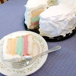 Rainbow Sherbet Cake Recipe - A delightfully refreshing summer dessert featuring orange, raspberry and lime sherbet layered with angel food cake.