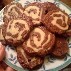 Black and White Pinwheels Recipe - A delicious buttery cookie that is made in two parts and put together to create a black and white pinwheel cookie. This recipe came from my grandmother, she used to worked in bakeries and at  logging camps cooking and baking.