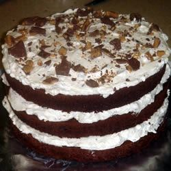 Chocolate Candy Bar Cake Recipe - I made this once for a family gathering and now everyone insists that it be at every gathering!  It's so easy; you use a box cake mix! For chopping the chocolate bars, I put them in the freezer, then hit them with a hammer while still in the wrapper