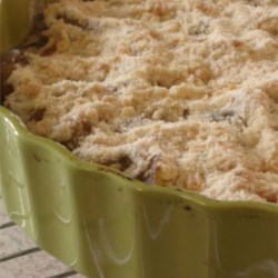 Zucchini Cobbler Recipe - It looks and tastes like apple cobbler, but the star of this yummy dessert is really zucchini. The zucchini is first cooked in lemon juice until tender. Then it 's sugared, splashed with nutmeg and cinnamon, and spread over a buttery crumb mixture in a 9x13-inch baking dish. More crumbs go on top, and then the cobbler is baked until golden and bubbly.