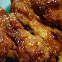 Japanese Chicken Wings Recipe - Chicken wings are egged and fried in butter, then baked in a tangy sauce of soy sauce, water, sugar, vinegar, garlic powder and salt.  Delicious, sticky chicken wings!