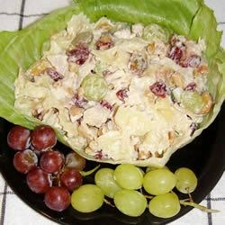 Chicken Pasta Salad with Cashews and Dried Cranberries Recipe - Everyone loves this chicken pasta salad loaded with crunchy cashews, juicy seedless grapes, and crisp water chestnuts, celery, and green onions. You won't go wrong serving this recipe.