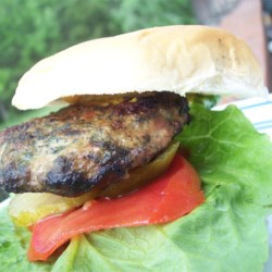 Goat Cheese and Spinach Turkey Burgers Recipe - Pile on the condiments, and a enjoy one of these tasty turkey burgers today! These are great when cooked on the grill.