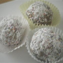 Spice Balls Recipe - Similar to doughnut holes, these sweet, deep fried balls are great plain or tossed with sugar and cinnamon. Fry 'em up, and pop 'em down!