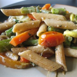 No-Cream Pasta Primavera Recipe - Spring veggies benefit from a quick roasting in olive oil and herbs before being tossed with penne. No cream here, just the fresh flavors of olive oil, balsamic vinegar, and lemon.
