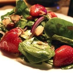 Spinach and Strawberry Daiquiri Salad Recipe - Get the taste of a strawberry daiquiri on a plate when you mix baby spinach with strawberries, coconut, and almonds, and toss it all in a tangy lime dressing.