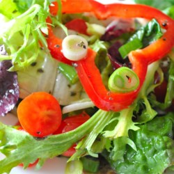 Italian Leafy Green Salad Recipe - This is a very, very healthy and hearty salad with a fabulous grapeseed oil and balsamic vinegar dressing. It offers a quartet of greens  - escarole, romaine, radicchio and green-leafed lettuce, as well as peppers, green onions and cherry tomatoes. Serves six.