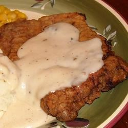 Chicken Fried Steak I Recipe - Old fashioned family favorite. Tenderized beef cutlets are dipped in buttermilk and egg batter, then fried. Pan drippings are used to make cream gravy.