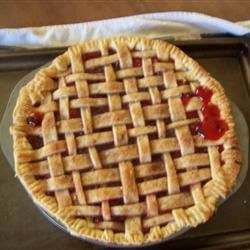 Deep Dish Cherry Pie Recipe - Lots and lots of sour cherries go into this pie and the end result is a slightly tart, juicy, incredibly delicious pie that goes well with scoops of vanilla ice cream.