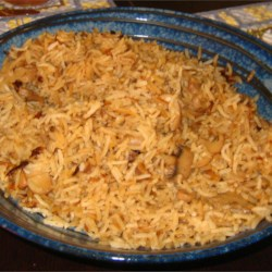 Mushroom Onion Rice Recipe - Easy, flavorful rice side dish using canned mushrooms and French onion soup. I grew up eating this once a week.