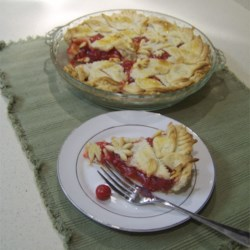 Best Cherry Pie Recipe - Sweet, thick and full of cherries, this pie is irresistible. The filling is whipped up from a classic combination of canned sour cherries, sugar, flour, and almond flavoring.