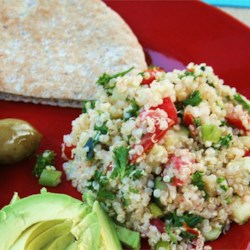 Quinoa Tabbouleh Recipe - Quinoa, once a staple grain of ancient Incas, is tossed with lemon juice, tomatoes, cucumber, carrots, green onions and parsley.  Serve with pita bread.