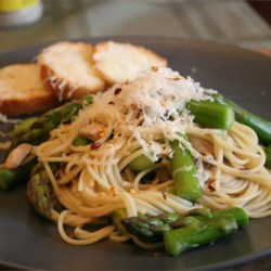 Pasta with Asparagus Recipe - Tender spears of fresh asparagus are simmered with chicken broth and sliced mushrooms. Tossed with angel hair pasta and Parmesan cheese, this makes a wonderful luncheon dish or light supper.