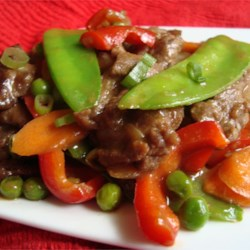 Filipino Beef Stir-Fry Recipe - This simple dish consists of marinated beef stir-fried with onion, garlic, snow peas, green peas, carrot, celery, and red bell pepper.