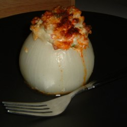 Peter's Baked Stuffed Onions Recipe - Vidalia onions are stuffed with a mixture of rice, sausage, bell pepper, cream cheese and herbs, and baked.