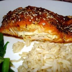 Sara's Soy Marinated and Cream Cheese-Stuffed Salmon Recipe - A sweet-savory soy sauce marinade sets the stage for these cream cheese and green onion-stuffed salmon fillets or steaks. Oven-baked, and finished with a splash of teriyaki sauce and a sprinkling of sesame seeds, they guarantee applause for the cook.