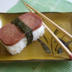 Spam Musubi Recipe and Video - Spam Musubi is a very popular Hawaiian snack that is just like sushi. Marinated sliced luncheon meat is quickly pan seared then placed on top of rice and wrapped in nori (dried seaweed.) Try it, you'll like it!