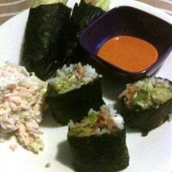 Spicy Tuna Sushi Roll Recipe - A fun sushi made with spiced-up canned tuna, carrots, cucumber, and avocado, rolled up in a nori sheet with lots of tangy rice.