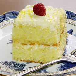 Lemon Cake Recipe - This is a wonderful easy recipe that is truly delicious. Lemon sheet cake with a cool lemony cream topping. Everyone who has tried it absolutely loves it.