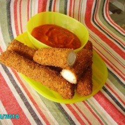 Homemade Mozzarella Sticks Recipe - Egg roll wrappers give these fried mozzarella sticks a pleasing crunch.