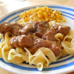 Slow Cooker Manly Stew Recipe - This stew is hearty and makes a great brown gravy. It is my family's favorite! Serve over garlic mash potatoes or egg noodles. We like to spice the potatoes up with a little hot sauce.
