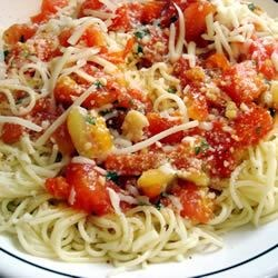 Cajun Pasta Fresca Recipe and Video - Vermicelli is tossed with a fresh roma tomato sauce, Cajun seasoning, mozzarella and Parmesan.