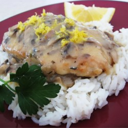 Lemon Mushroom Herb Chicken Recipe - Herbed chicken is blanketed by a cream of mushroom sauce with a lovely lemon-wine accent.