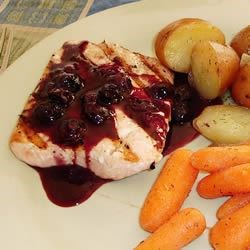 Grilled Salmon Steaks with Savory Blueberry Sauce Recipe - Blueberry balsamic sauce serves as a sensational topping for grilled salmon in this summery dish.