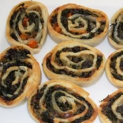 Spinach and Mushroom Pinwheels Recipe - Here, a savory medley of vegetables and cheese gets blanketed--jelly-roll-style--in homemade pastry dough.