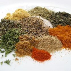 Chicken Seasoning Blend Recipe - Basil, rosemary, and garlic provide a base of flavors for this seasoning blend. This dry mix of herbs and spices adds a unique zing to any chicken dish. It has just the right amount of heat and flavor to make all your guests beg for more. Don't be scared by the long list; most of it is spices you will probably have in your cupboard. Note, it also gives chili a great flavor without adding too much heat.