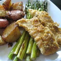 Amy's Garlic Egg Chicken Recipe - An egg yolk/garlic marinade tenderizes these chicken breasts before they are dipped in a seasoned crumb mixture and baked.