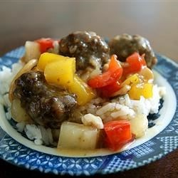 Lana's Sweet and Sour Meatballs Recipe - Beef meatballs in a pineapple and brown sugar sauce with pineapple chunks, carrot, and green pepper. It's great as a main dish, but can also be used as an appetizer.