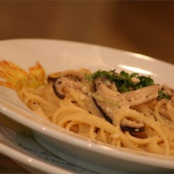 Shiitake Angel Hair Pasta Recipe - Fresh shiitake mushrooms, sauteed in garlic and onion, is simmered in a reduction of wine, stock and cream, then tossed with delicate strands of angel hair pasta and served with a dusting of Parmesan and parsley.