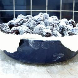Grandma's Blackberry Pie Recipe - Slices of apple soak up the juices from the blackberries as this simple pie bakes in the oven.