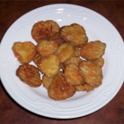 Fried Dill Pickles Recipe - Dill pickle slices are breaded, then deep fried in peanut oil. A great snack.
