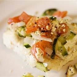 Baked Halibut Steaks Recipe - An Italian-style vegetable and feta cheese topping is the perfect enhancement to delicious baked halibut.