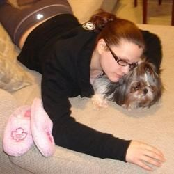 Me and my Shih-Tzu, Cookie, watching TV at home.