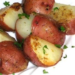 Lemon Horseradish New Potatoes Recipe - New potatoes are baked in a savory sauce of butter, horseradish and lemon juice.  Spoon the sauce over the potatoes when serving, and garnish with fresh parsley and lemon wedges, if desired.
