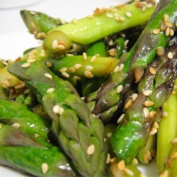 Awesomely Easy Sesame Asparagus Recipe - Asparagus is steamed and then tossed with olive oil, kosher salt and toasted sesame seeds.