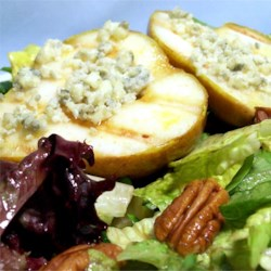 Grilled Blue Cheese Pears Recipe - Grilling pears basted with hot sauce and filled with blue cheese makes a deliciously unique side dish.